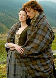Picture of the characters that played the roles of Jamie and Claire in the Outlander tv series.